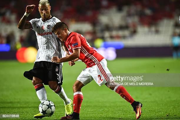 Benfica's Argentinian midfielder Franco Cervi vies with Besiktas' Portuguese forward Ricardo Quaresma during the UEFA Champions League football match...