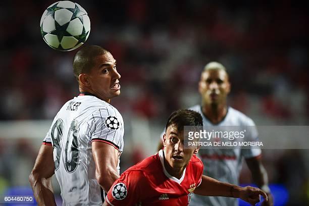 Benfica's Argentinian midfielder Franco Cervi vies with Besiktas' Swiss midfielder Gokhan Inler during the UEFA Champions League football match SL...
