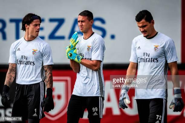 Benfica's Belgian goalkeeper Mile Svilar Benfica's German goalkeeper Odisseas Vlachodimos and Benfica's Russian goalkeeper Ivan Zlobin arrive for a...