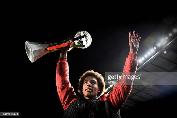 Benfica's Belgium midfielder Axel Witsel celebrates holding the Portuguese League Cup after winning the match against Gil Vicente at Coimbra Stadium...