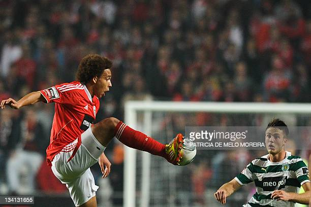 Benfica's belgium midfielder Axel Witsel fights for the ball with Sporting's Dutch forward, Van Wolfswinkel during their Portuguese league football...