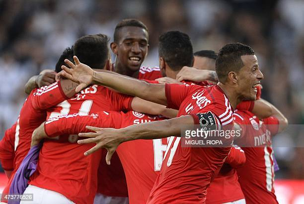 Benfica's Benfica's Brazilian forward Rodrigo Lima celebrates next to teammates at the end of the Portuguese league football match Vitoria SC vs SL...