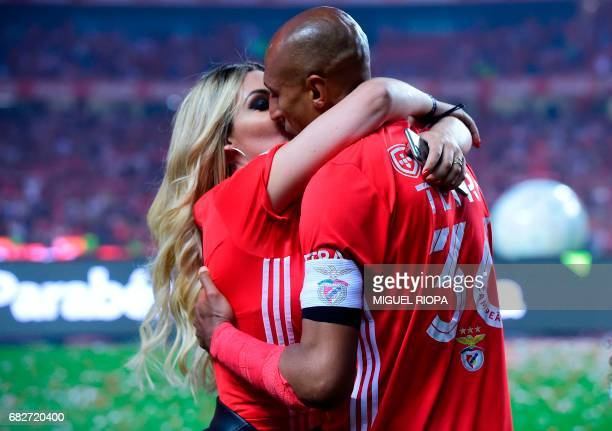 Benfica's Brazilian defender and captain Luisao kisses his wife after winning their 36th title at the end of the Portuguese league football match SL...
