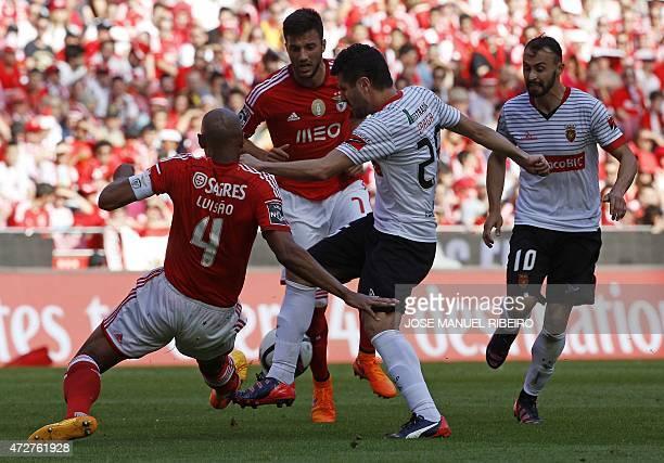 Benfica's Brazilian defender Anderson da Silva 'Luisao' and Greek midfielder Andreas Samaris vie with Penafiel's midfielder Bruno Braga past...