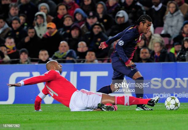 Benfica's Brazilian defender Anderson Luis da Silva vies with Barcelona's midfielder Rafael Alcantara during the UEFA Champions League football match...