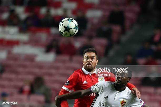 Benfica's Brazilian defender Jardel fights for the ball with Basel's forward Dimitri Oberlin from Suisse during the UEFA Champions League Group A...