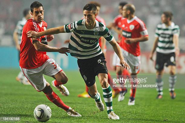 Benfica's brazilian defender, Jardel fights for the ball with Sporting's Dutch forward, Van Wolfswinkel R during their Portuguese league football...