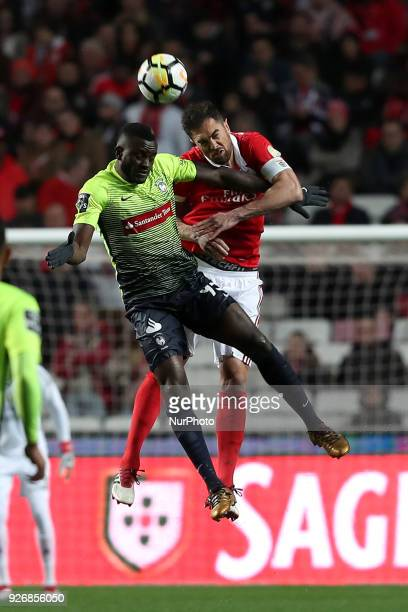 Benfica's Brazilian defender Jardel heads the ball with Maritimo's forward Joel Tagueu during the Portuguese League football match SL Benfica vs...