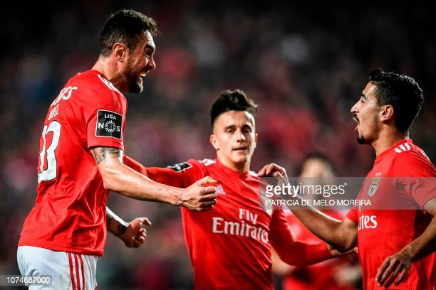 Benfica's Brazilian defender Jardel Vieira celebrates a goal with teammates Benfica's Argentine forward Franco Cervi and Benfica's defender Andre...