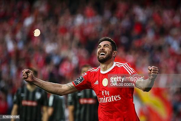 TOPSHOT Benfica's Brazilian defender Jardel Vieira celebrates after scoring a goal during the Portuguese league football match SL Benfica vs Vitoria...