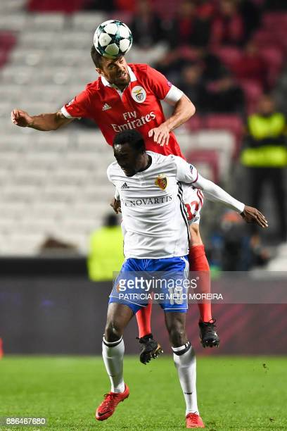 Benfica's Brazilian defender Jardel Vieira heads the ball behind Basel's forward Dimitri Oberlin during the UEFA Champions League football match SL...