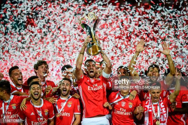 Benfica's Brazilian defender Jardel Vieira holds up the winner's trophy after winning the Portugal's Super Cup final football match between SL...