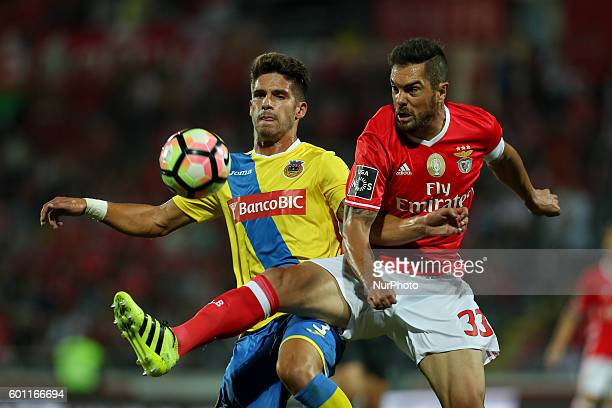 Benfica's Brazilian defender Jardel vies with Arouca's Portuguese defender Hugo Bastos during Premier League 2016/17 match between FC Arouca and SL...