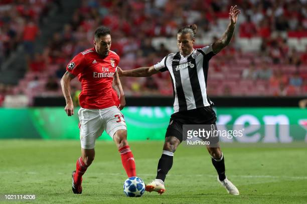 Benfica's Brazilian defender Jardel vies with PAOK's forward Aleksandar Prijovic from Serbia during the UEFA Champions League playoff first leg match...