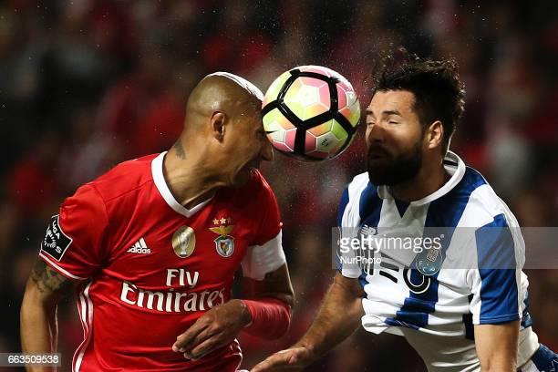Benfica's Brazilian defender Luis Da silva 'Luisao' vies with Porto's defender Felipe Monteiro during the Portuguese League football match between SL...