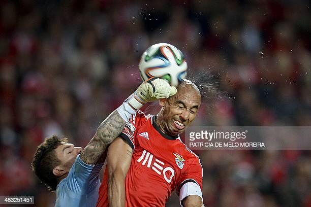 """Benfica's Brazilian defender Luis Da silva """"Luisao"""" vies with Rio Ave's Brazilian goalkeeper Ederson Moraes during the Portuguese league football..."""