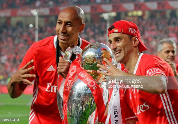 Benfica's Brazilian defender Luisao and forward Jonas hold the cup after winning their 36th title at the end of the Portuguese league football match...