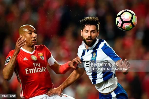 Benfica's Brazilian defender Luisao da Silva heads the ball with Porto's Brazilian defender Felipe Monteiro during the Portuguese league football...
