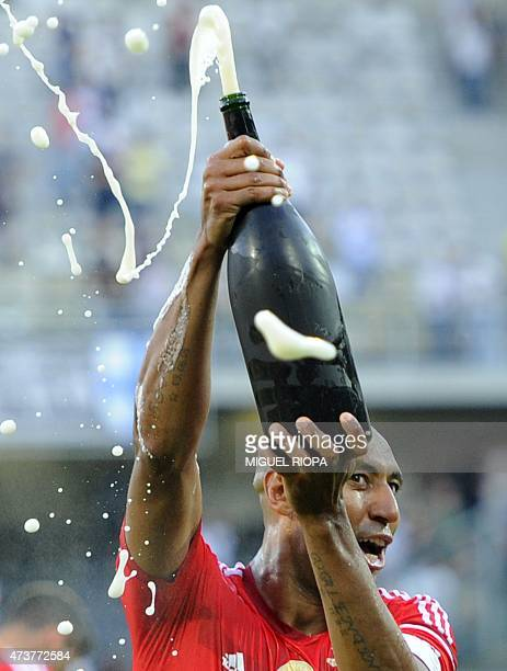 Benfica's Brazilian defender Luisao Silva celebrates with champagne at the end of the Portuguese league football match Vitoria SC vs SL Benfica at...