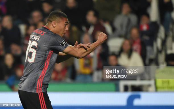 Benfica's Brazilian forward Carlos Vinicius celebrates after scoring a goal during the Portuguese league football match between Gil Vicente FC and SL...