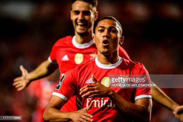 Benfica's Brazilian forward Carlos Vinicius celebrates after scoring during the Portuguese league football match between SL Benfica and Vitoria FC at...