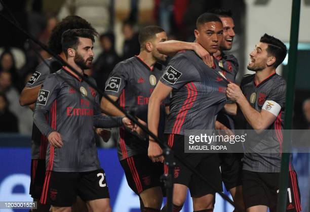 Benfica's Brazilian forward Carlos Vinicius is congratulated by teammates after scoring a goal during the Portuguese league football match between...