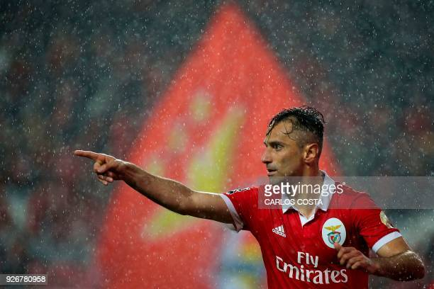 Benfica's Brazilian forward Jonas celebrates a goal during the Portuguese league football match between SL Benfica and CS Maritimo at the Luz stadium...