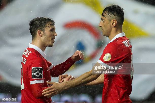 Benfica's Brazilian forward Jonas celebrates a goal with Benfica's Spanish midfielder Alex Grimaldo during the Portuguese league football match...