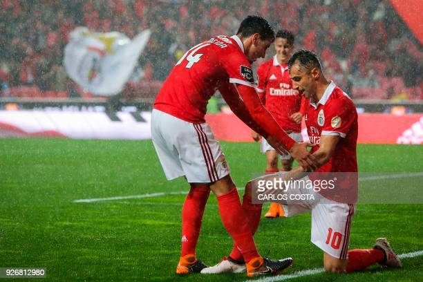Benfica's Brazilian forward Jonas celebrates a goal with Benfica's defender Andre Almeida during the Portuguese league football match between SL...