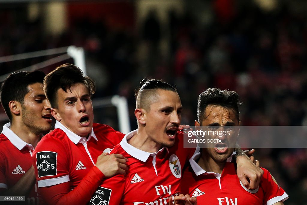 Benfica's Brazilian forward Jonas (R) celebrates a goal with teammates during the Portuguese league football match between SL Benfica and CD Aves at the La Luz stadium in Lisbon on March 10, 2018. /