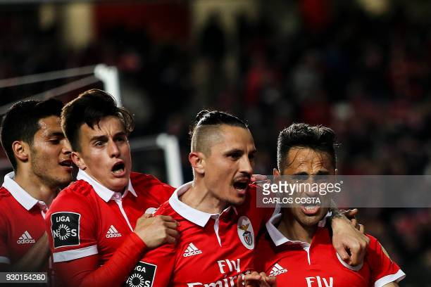 Benfica's Brazilian forward Jonas celebrates a goal with teammates during the Portuguese league football match between SL Benfica and CD Aves at the...