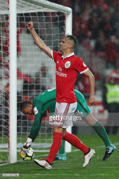 Benfica's Brazilian forward Jonas celebrates after scoring a goal during the Portuguese League football match SL Benfica vs Maritimo at the Luz...