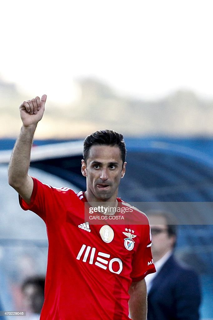 Benfica's Brazilian forward Jonas celebrates after scoring during the Portuguese league football match CF Os Belenenses v SL Benfica at the Restelo stadium in Lisbon on April 18, 2015.