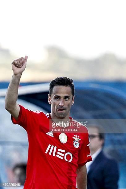 Benfica's Brazilian forward Jonas celebrates after scoring during the Portuguese league football match CF Os Belenenses v SL Benfica at the Restelo...