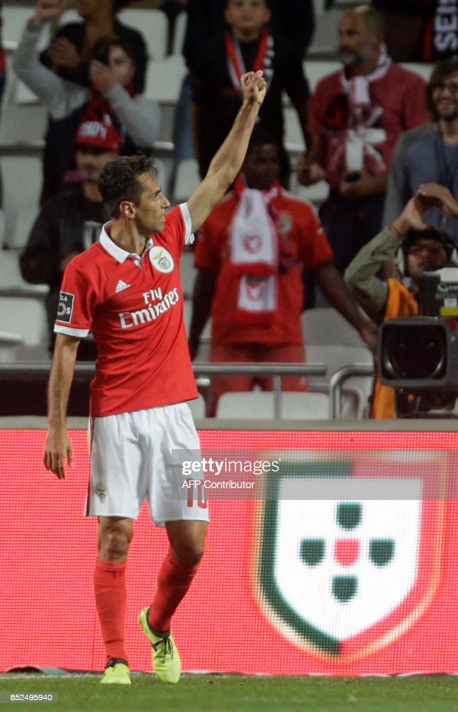 Benfica's Brazilian forward Jonas celebrates after scoring during the Portuguese league football match SL Benfica vs FC Pacos de Ferreira at the Luz stadium in Lisbon on September 23, 2017. /
