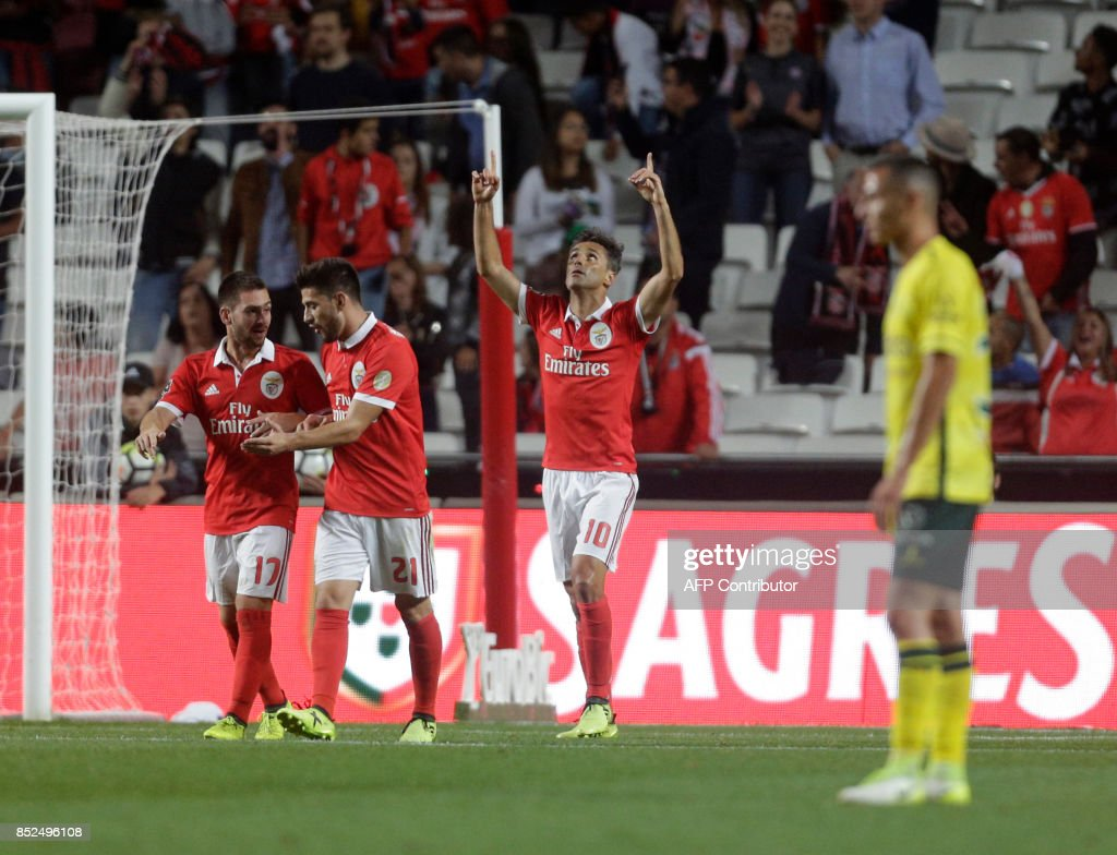 Benfica's Brazilian forward Jonas (C) celebrates after scoring during the Portuguese league football match SL Benfica vs FC Pacos de Ferreira at the Luz stadium in Lisbon on September 23, 2017. /
