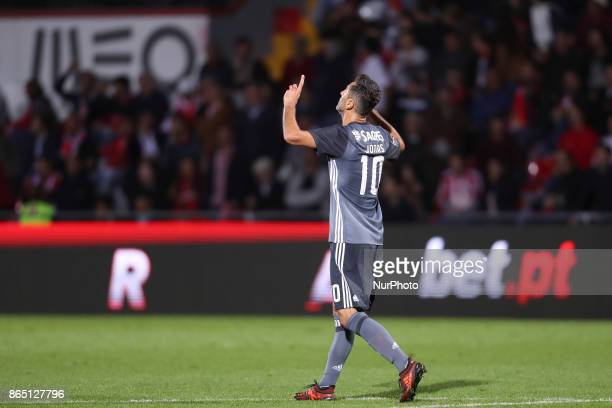 Benfica's Brazilian forward Jonas celebrates after scoring goal during the Premier League 2017/18 match between CD Aves and SL Benfica at Estadio do...