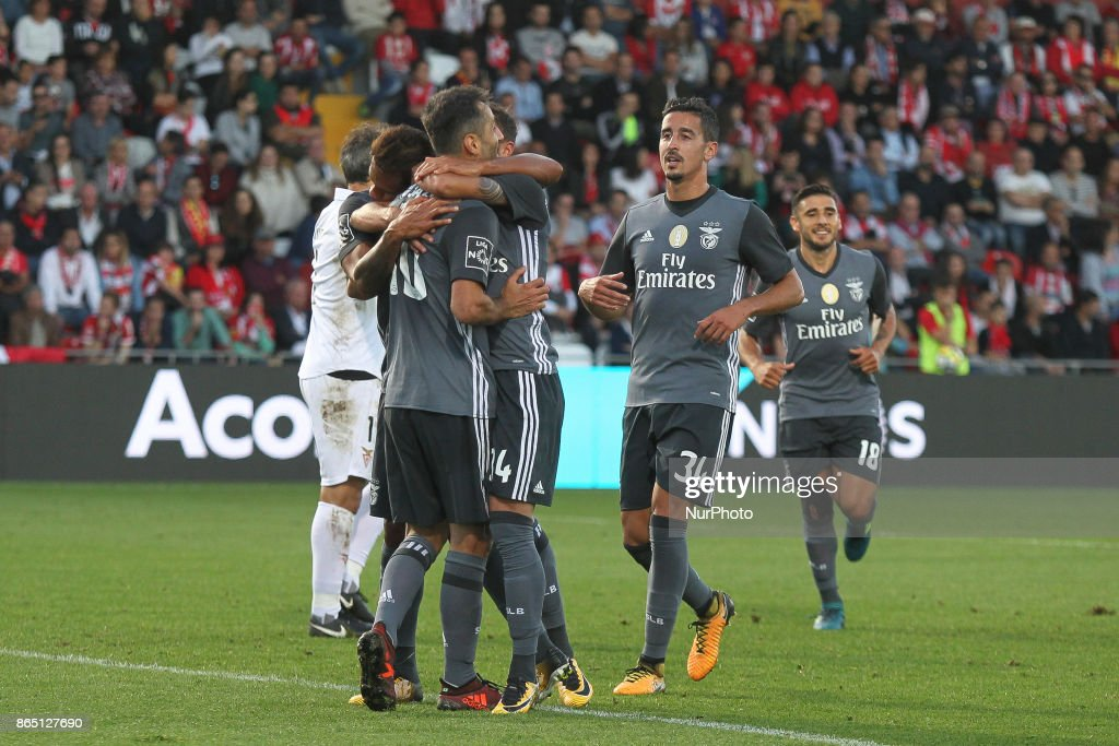 Benfica's Brazilian forward Jonas (L) celebrates after scoring goal with teammates during the Premier League 2017/18 match between CD Aves and SL Benfica, at Estadio do Clube Desportivo das Aves in Aves on October 22, 2017.