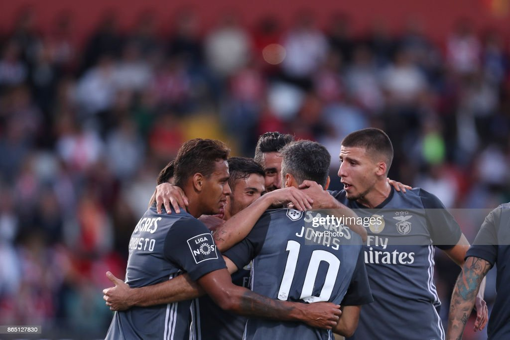 Benfica's Brazilian forward Jonas celebrates after scoring goal with teammates during the Premier League 2017/18 match between CD Aves and SL Benfica, at Estadio do Clube Desportivo das Aves in Aves on October 22, 2017.