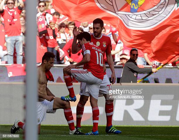 Benfica's Brazilian forward Jonas celebrates his goal with Argentinian midfielder Nico Gaitan and Brazilian defender Jardel during the Portuguese...