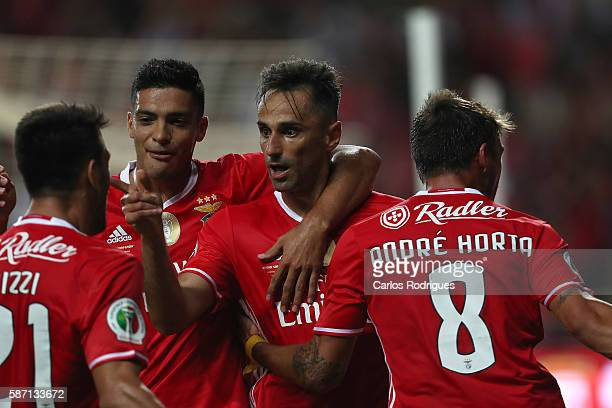 Benfica's Brazilian forward Jonas celebrates scoring Benfica«s second goalwith his team mates during the match between SL Benfica v SC Braga for...