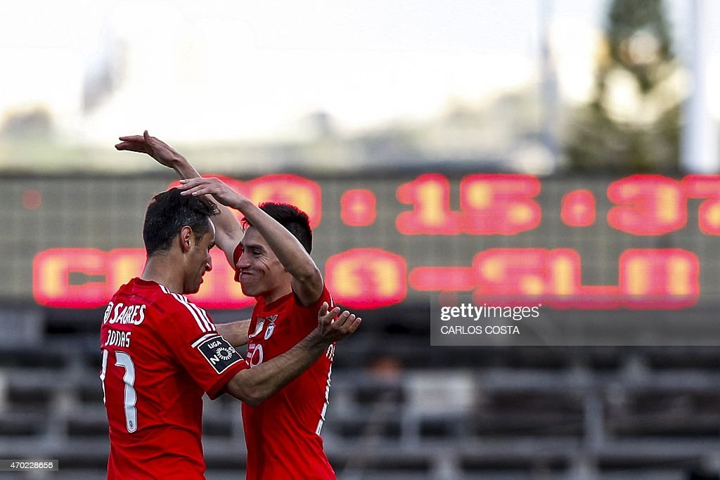 Benfica's Brazilian forward Jonas (L) celebrates with Benfica's Argentinian midfielder Nicolas Gaitan (R) after scoring during the Portuguese league football match CF Os Belenenses v SL Benfica at the Restelo stadium in Lisbon on April 18, 2015.