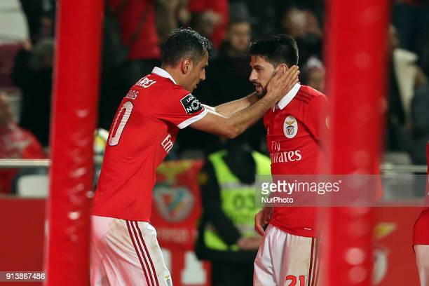 Benfica's Brazilian forward Jonas celebrates with Benfica's Portuguese midfielder Pizzi after scoring during the Portuguese League football match SL...