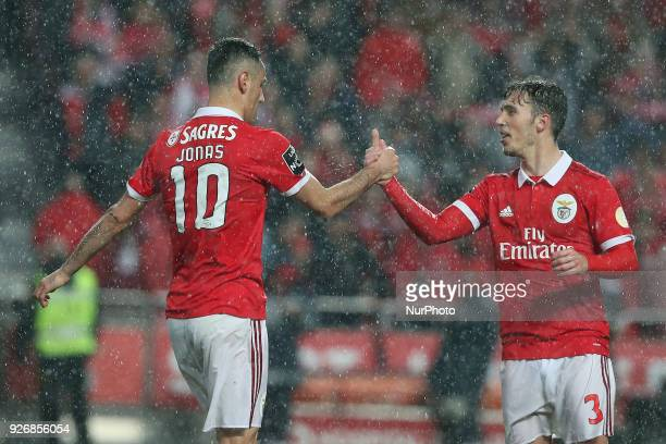 Benfica's Brazilian forward Jonas celebrates with Benfica's Spanish defender Alejandro Grimaldo after scoring a goal during the Portuguese League...