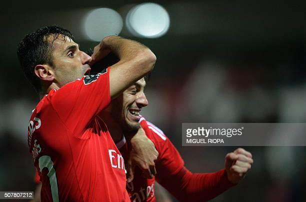 Benfica's Brazilian forward Jonas celebrates with teammate midfielder Pizzi after scoring a goal during the Portuguese league football match...