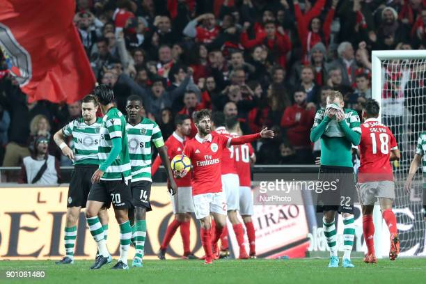 Benfica's Brazilian forward Jonas celebrates with teammates after scoring during the Portuguese League football match SL Benfica vs Sporting CP at...