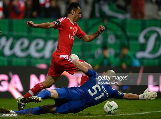 Benfica's Brazilian forward Jonas controls the ball next to Moreirense's Serbian goalkeeper Igor Stefanovic to score a goal during the Portuguese...