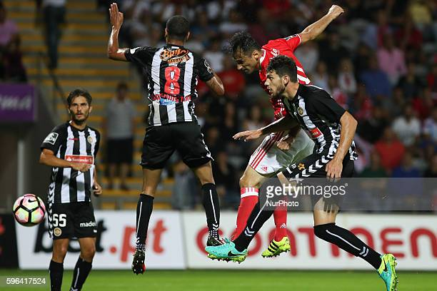 Benfica's Brazilian forward Jonas in action with Nacional's Brazilian midfielder Washington Silva and Nacional's Portuguese defender Tobias...
