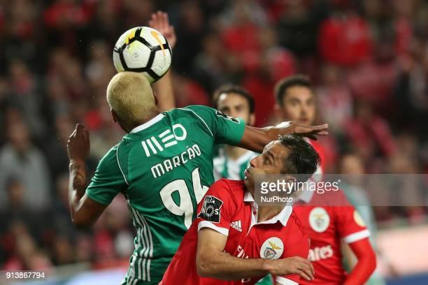 Benfica's Brazilian forward Jonas looks on as Rio Ave's defender Marcao heads the ball during the Portuguese League football match SL Benfica vs Rio...