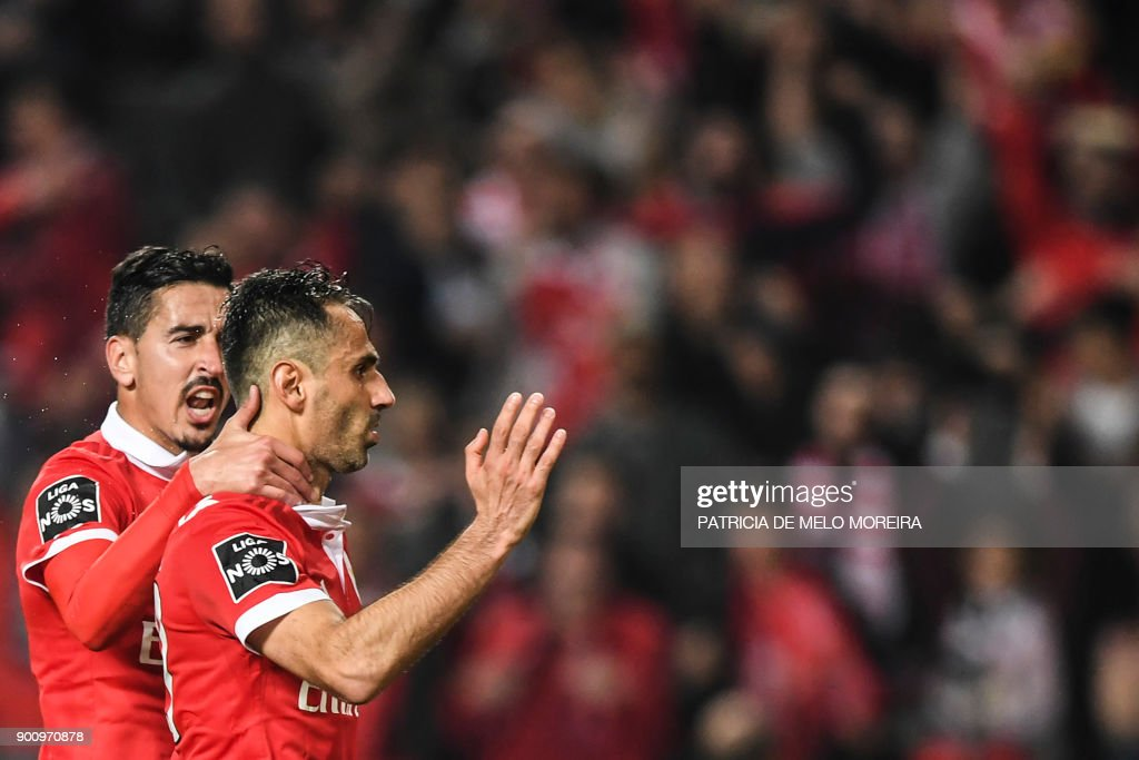 Benfica's Brazilian forward Jonas Oliveira (R) celebrates a goal with teammate Benfica's defender Andre Almeida during the Portuguese league football match SL Benfica vs Sporting CP at the Luz stadium in Lisbon on January 3, 2018. /